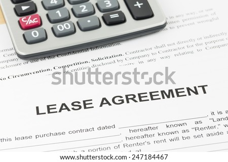 Lease agreement document with calculator - stock photo