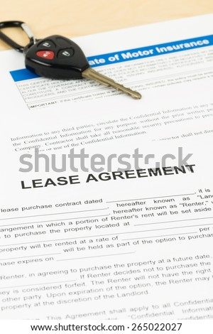 Lease agreement with car key; document is mock-up - stock photo