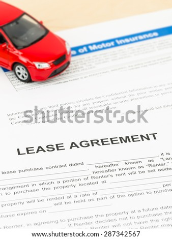 Lease agreement with car model; document is mock-up - stock photo