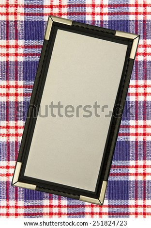 leather and paper menu over a tablecloth - stock photo