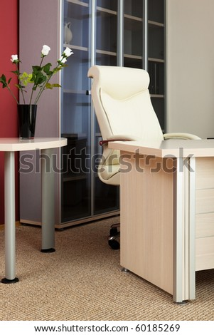 Leather armchair director in a modern office - stock photo