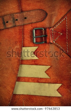 Leather background with paper tag label ribbon - stock photo