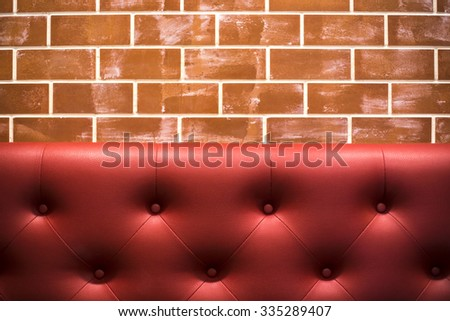 Leather background with red brick floor. - stock photo