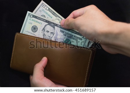 leather bag for save money on background and selective focus. - stock photo