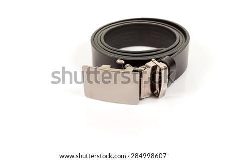 Leather belt closeup on white background. - stock photo