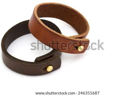 Leather bracelet on white background - stock photo