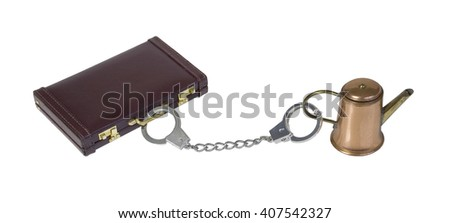 Leather briefcase attached to coffee pot via handcuffs - path included - stock photo