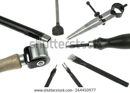 leather craft tools isolate on white background - stock photo