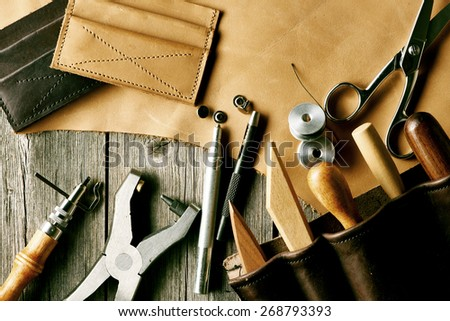 Leather crafting tools still life - stock photo