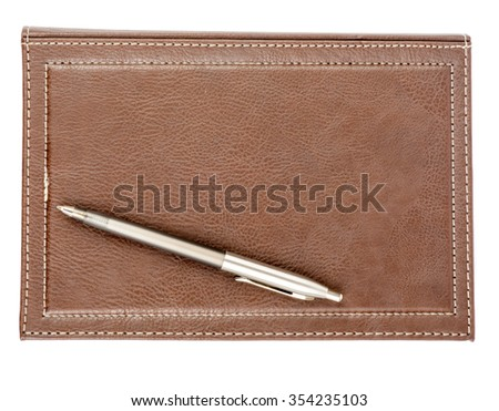 Leather daily planner with pen on isolated white background - stock photo