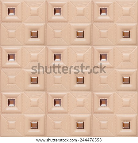 Leather decorative tile with volume drawing and inserts of a mirror, nobody. - stock photo