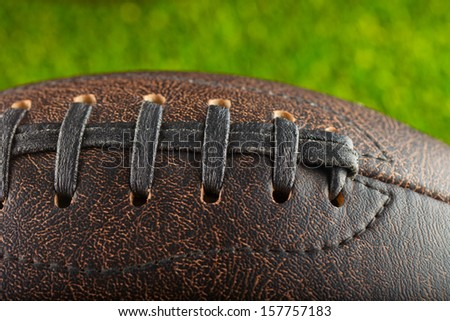 Leather Football in strict closeup with grass in the back - stock photo