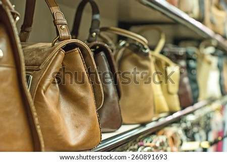 Leather handbags collection in the store. - stock photo