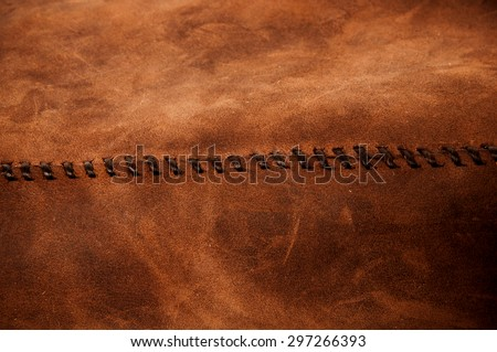 Leather Handmade Stitch (Brown Tan). Handcrafted Leather, Hand Sewing, Stitching and Crafting. Rustic Style. Background Textured and Wallpaper. - stock photo