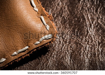 Leather Handmade Stitch Detail, Handcrafted Leather Goods, Hand Sewing and Stitching. Rustic Style. Close up on Craftsman Workspace. - stock photo
