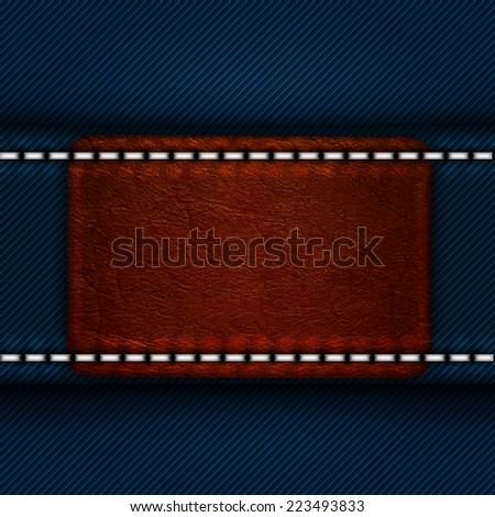 leather label sewn to denim blue jeans - stock photo