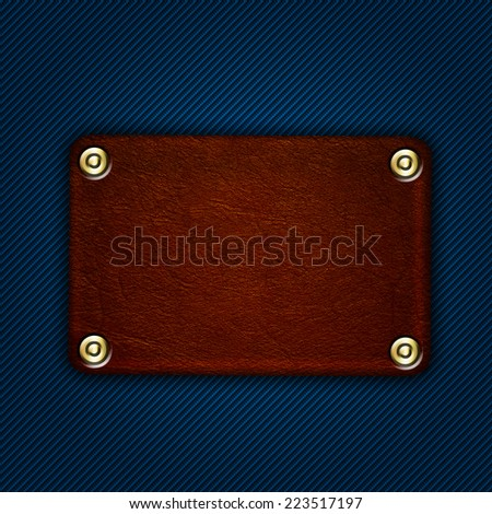 leather label with rivets on denim blue jeans - stock photo