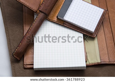 Leather memo and note with a pen - stock photo