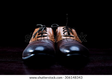 Leather men's shoes on a black background - stock photo