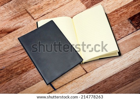 leather notebook and open notebook - stock photo
