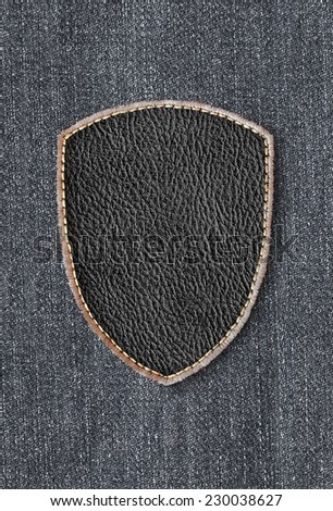 Leather patch on denim - stock photo