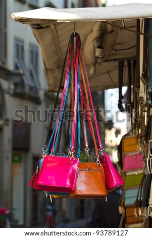 Leather purses for sale on a street vendors cart in Florence, Italy - stock photo