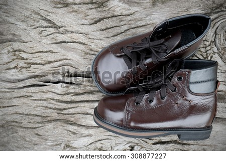 leather shoes on wooden table - stock photo
