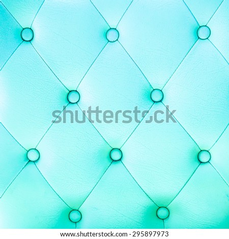 leather sofa color blue background - stock photo