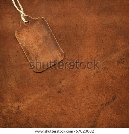Leather tag on the background of suede - stock photo