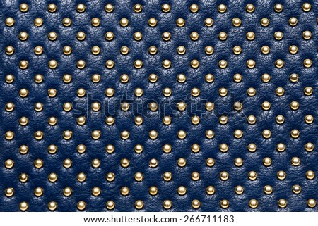 leather texture with gold beads   - stock photo