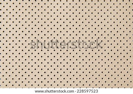 leather texture with small black holes, abstract background - stock photo