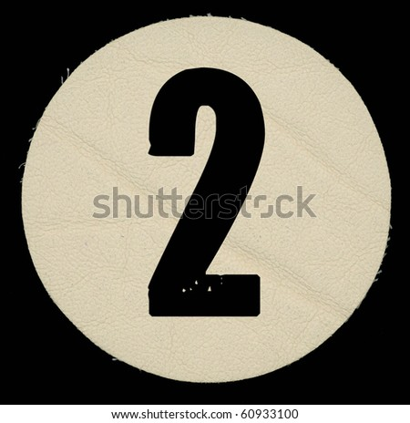 Leather two number , on a black isolated background. - stock photo