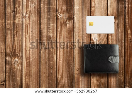 Leather wallet and credit card mock-up on wooden table - stock photo