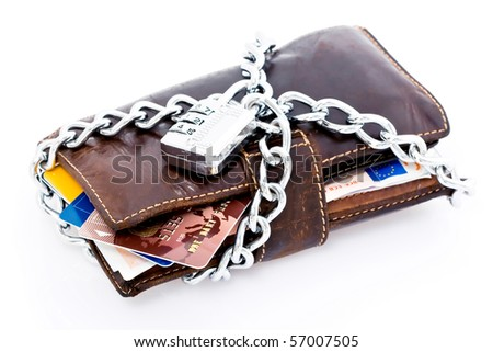 Leather wallet with credit cards and Euro currency locked with a chain and combination lock, isolated on white background - stock photo