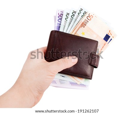 leather wallets in hand and European Currency, euro ( 50, 100, 500 ) - stock photo