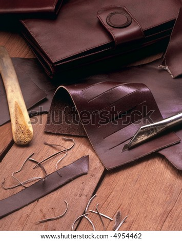 leather wallets maker tools still life - stock photo