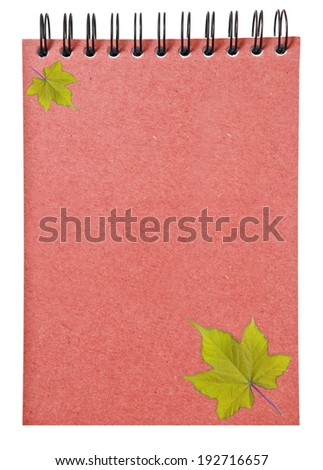 leaves on  ring binder red book isolated on white background, clipping path - stock photo