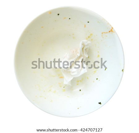 leavings on a white dish, isolate on white. - stock photo