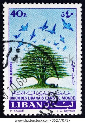 LEBANON - CIRCA 1960: a stamp printed in Lebanon shows Cedar and Birds, Union of Lebanese Emigrants in the World, circa 1960 - stock photo