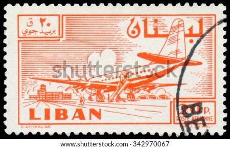 LEBANON - CIRCA 1958: a stamp printed in Lebanon shows Douglas DC-6B plane at Khalde airport - stock photo