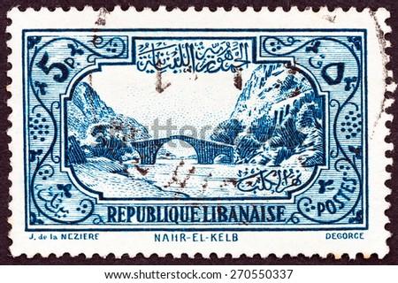 LEBANON - CIRCA 1940: A stamp printed in Lebanon shows Nahr el-Kalb Bridge, circa 1940.  - stock photo