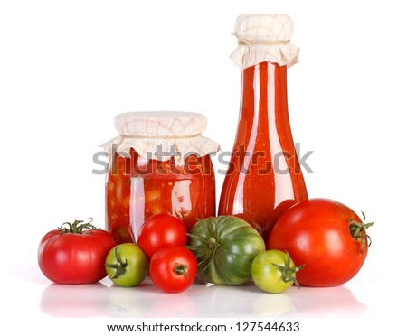 Lecho and ketchup in glass jar with fresh vegetables on white background - stock photo