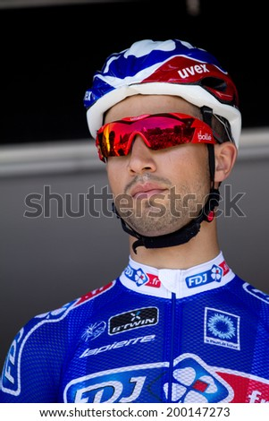 LECTOURE, FRANCE - JUNE 20  Portrait of the french sprinter Nacer Bouhanni at the departure of the first stage of the Route du Sud, on June 20, 2014 in Lectoure, France.   - stock photo