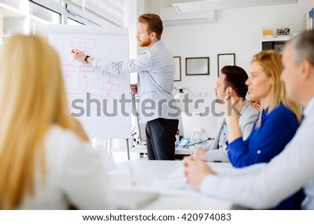 Lecture and  training  in business office for white collar colleagues - stock photo