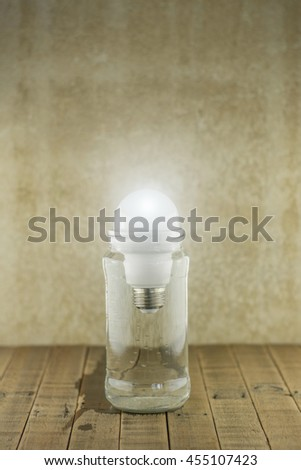 LED bulbs on wood background,Energy saving concept,Natural energy concept,Energy from water concept. - stock photo