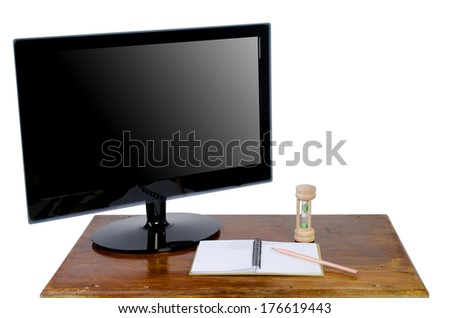 LED Computer monitor screen on wood table isolated on white - stock photo