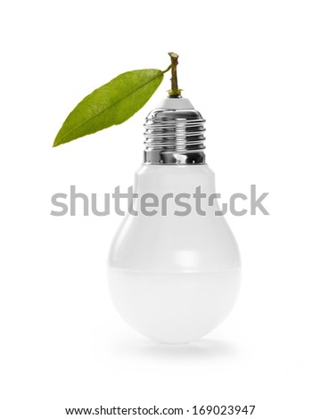 LED lamp with green leaf, ECO energy concept, close up - stock photo