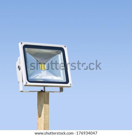 LED spotlight isolated on blue background - stock photo