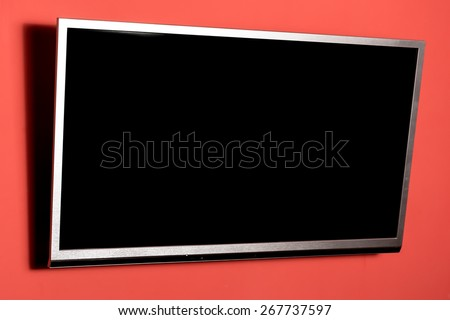 Led tv hanging on the red wall - stock photo