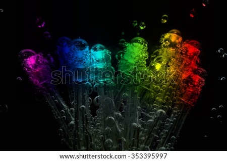LEDs with gas bubbles are dipped in mineral water. - stock photo